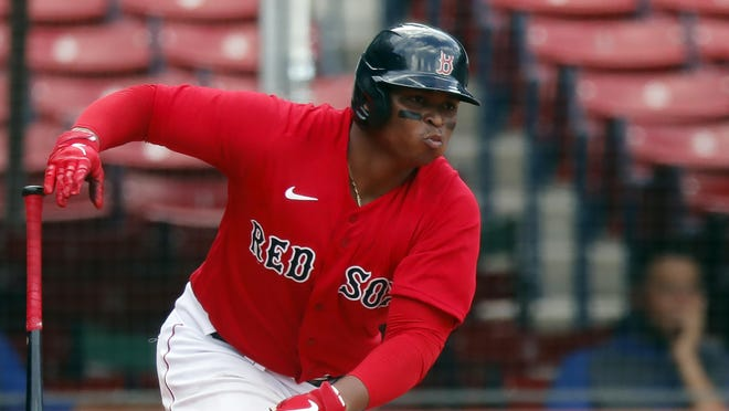 Rafael Devers gets serious in the ninth inning Sunday.
