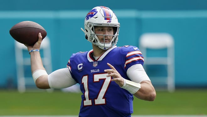 Buffalo Bills quarterback Josh Allen looks to pass against the Miami Dolphins on Sept. 20. He passed for 417 yards and four touchdowns.