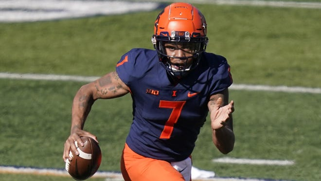 Illinois quarterback Coran Taylor scrambles during the first half of an NCAA college football game against Purdue Saturday, Oct. 31, 2020, in Champaign, Ill.
