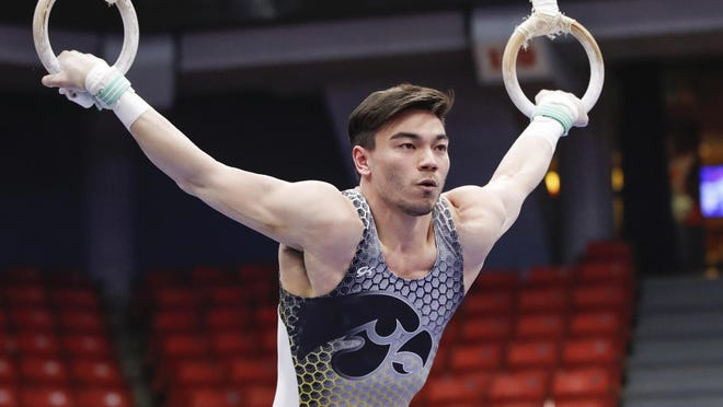 Iowa's Brandon Wong competes during a gymnastics meet on Saturday, Jan. 18, in Chicago.