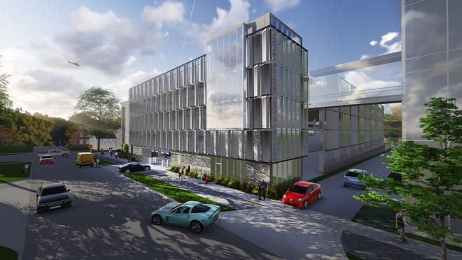 An artist's rendering shows what a proposed construction project on the site of the former Sabin Elementary School would look like. The project would include a roughly 640-space, four-level parking ramp wrapped in 28 two-level stacked condos.