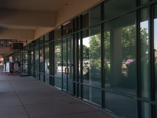 The Outlets at Loveland have a number of vacant storefronts Sunday, August 28, 2016.