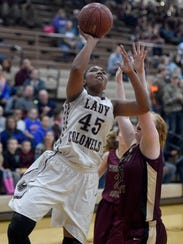 Alisha Owens of Henderson County makes a basket over