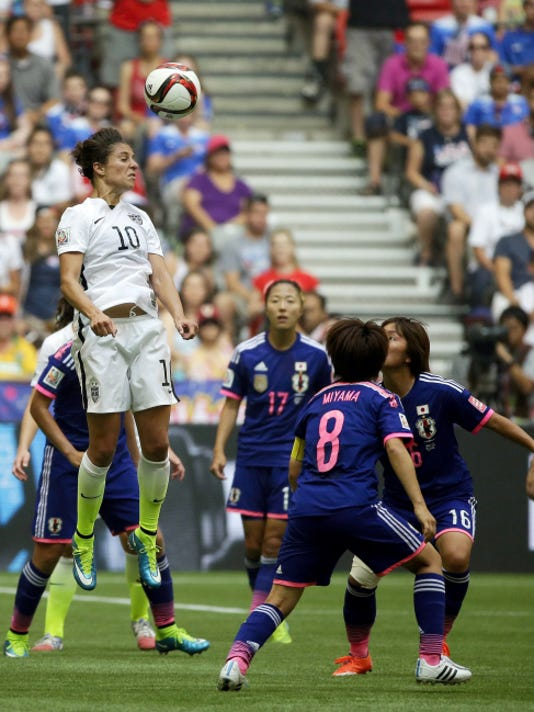 United States' Carli Lloyd (10) heads the ball against Japan during the second half of the FIFA Women's World Cup soccer championship in Vancouver, British Columbia July 5.