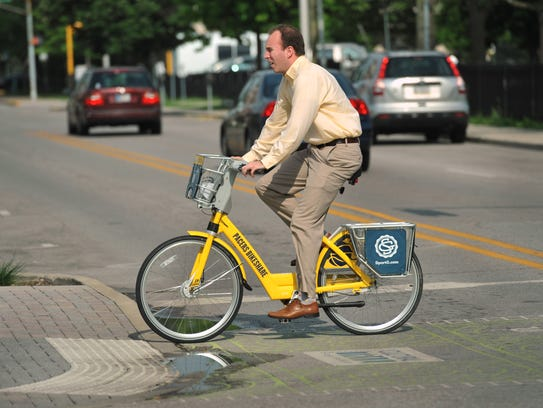 A rider heads up Alabama Street on a Pacers Bikeshare