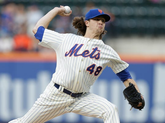 New York Mets' Jacob deGrom delivers a pitch during the first inning of a baseball game against the San Francisco Giants on Saturday, Aug. 2, 2014, in New York. (AP Photo/Frank Franklin II)