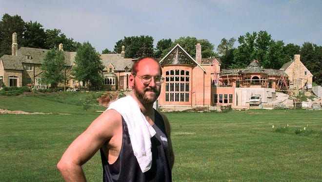 Scott Jones, shown in July 1998, while his Carmel mansion was still under construction.
