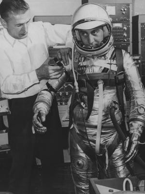 "Space Suit Technician Joe W. Sclmitt (left) does a series of pressure suit tests at NASA Mercury Headquarters on Project Mercury Astronaut Virgil I. ""Gus"" Grissom. (1/2/1962)"