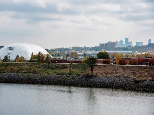 The greenway at Metro Center and the white dome of the Titans' practice facility are directly across the river from the new homes on Alice Street.