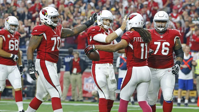 Arizona Cardinals quarterback Carson Palmer (3) greets wide receiver Larry Fitzgerald (11) after the two connected for a touchdown against the Green Bay Packers in the 2nd quarter of  their NFL game Sunday, Dec. 27, 2015 in Glendale, AZ.