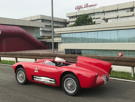 The 1955 Alfa Romeo Competizione is parked outside