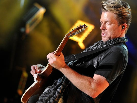 Joe Don Rooney, of Rascal Flatts, performs onstage