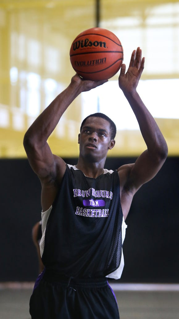 Brownsburg's K.J. Walton shoots a free throw during the school's game against Arsenal Tech at the high school recruiting event held at Warren Central High School on Saturday, June 21, 2014.
