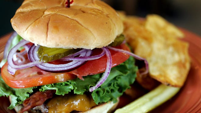 The $7 burger Shady Lane Cafe at 4806 Brownsboro Road stars beneath a humble Sara Lee bun with home-fried potato chips.