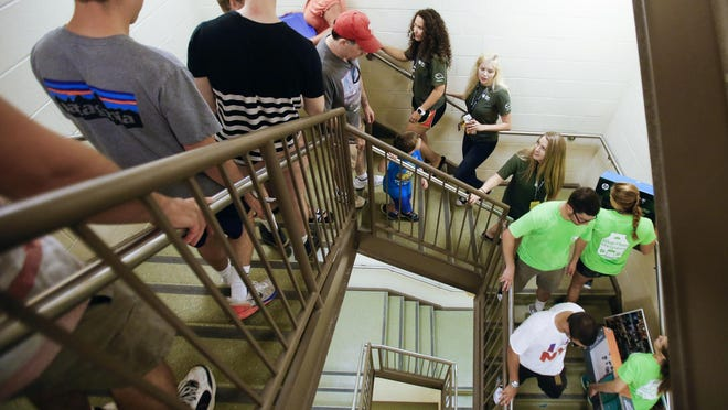 University of Delaware students move into Louis L. Redding Hall. A draft report outlines steps the school should take to improve diversity.