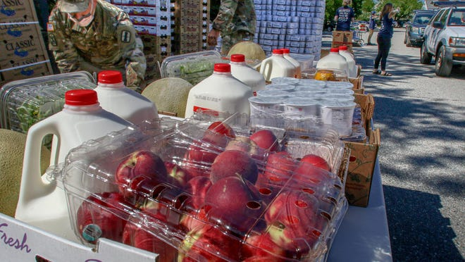 Milk and produce were handed out May 27 at a Farmers Feeding Families event in the McCoy Stadium parking lot in Pawtucket.