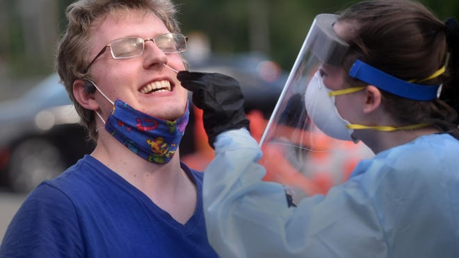 University of New Hampshire senior Benjamin Kerns is an animal sciences major who lives in a single at Gibbs Hall on campus. Kerns along with more than 1,000 others got tested for COVID-19 at the school's football stadium Monday.