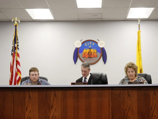 Commissioners Mark Lewis, left, Austin Randall, Victor Snover, Sherri Sipe and Rosalyn Fry take a seat on Monday at Aztec City Hall.