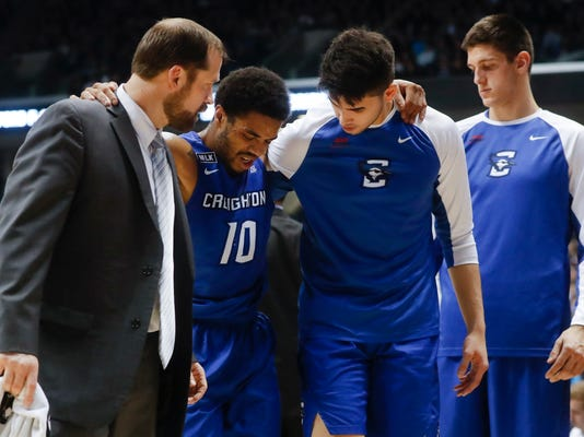 Creighton's Maurice Watson Jr. (10) is helped off the court with an injury in the first half of an NCAA college basketball game, Monday, Jan. 16, 2017, in Cincinnati. Watson Jr. was later carried off the court after reentering the game and being injured again. (AP Photo/John Minchillo)