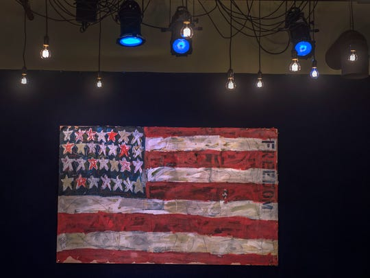The American Flag painting that was part of the old Family Wash still hangs above the new stage.
