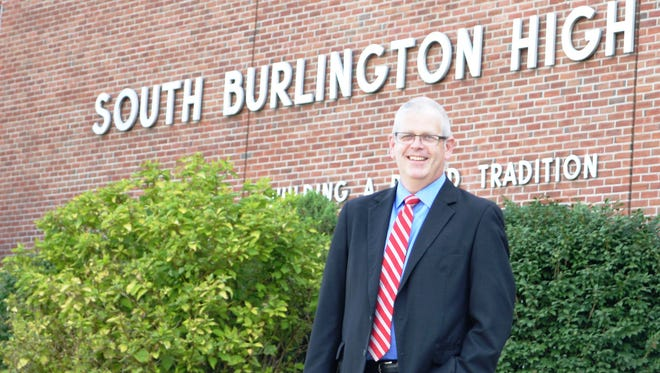South Burlington High School Principal Patrick Burke is back in action after beating cancer at South Burlington High School on Wednesday.
