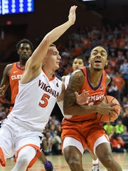 Virginia guard Kyle Guy (5) guards Clemson guard Marcquise Reed (2) during the 1st half on Tuesday, January 23, 2018, at UVA's John Paul Jones Arena in Charlottesville, Va.