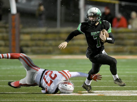 Clear Fork's Blake Dinsmore avoids the tackle of Dalton Hay of Bellevue on Friday night at Mansfield Senior High School.