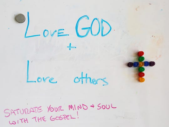 A small white board with a simple message just inside the front door Wednesday, September 14, 2016, at Trinity Life Ministry's rehab center, 1101 Whitlock Avenue in Crawfordsville. The center uses Christian-based counseling to help men overcome addiction.