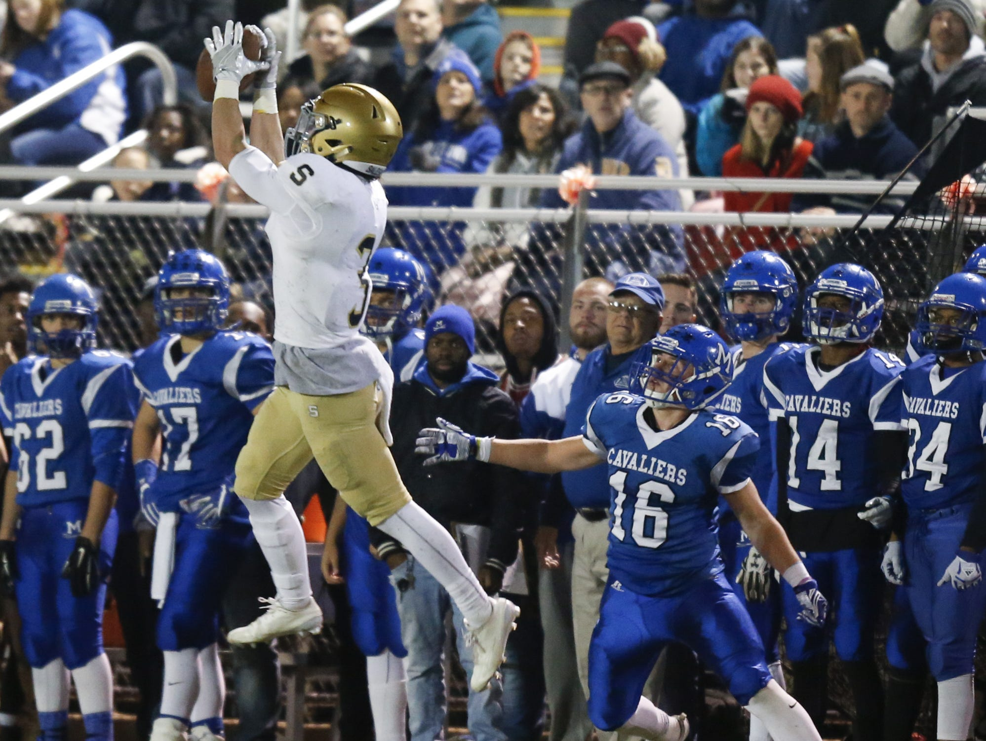 Salesianum's Michael Drake gets an interception in front of Middletown receiver Nick Johnston in the second quarter of a DIAA Division I state tournament semifinal at Cavalier Stadium Friday.