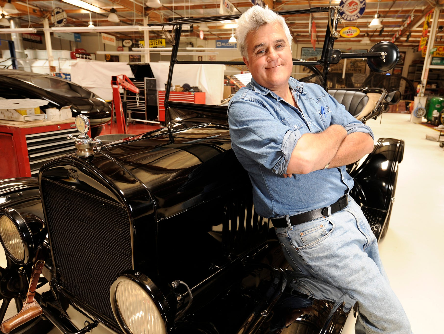 Talk show host Jay Leno poses with his 1925 Ford Model T Roadster on June 23, 2008, in Burbank, Calif.