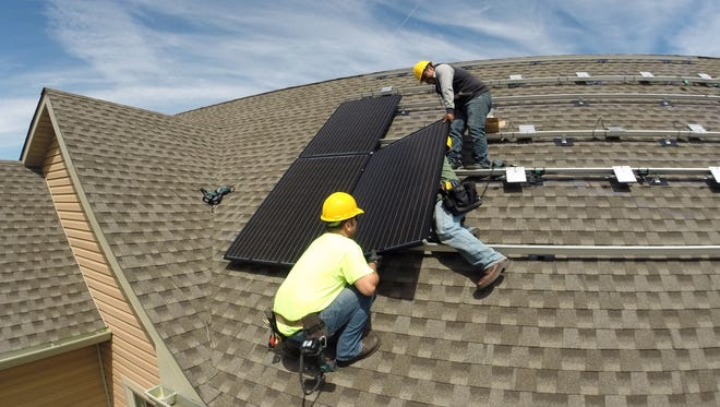 Solar panels are installed on a house in Walden, Orange County, by YSG Solar April 30, 2015.