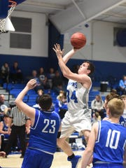 Cotter's Landon Martin puts up a shot on Tuesday night against Mammoth Spring.