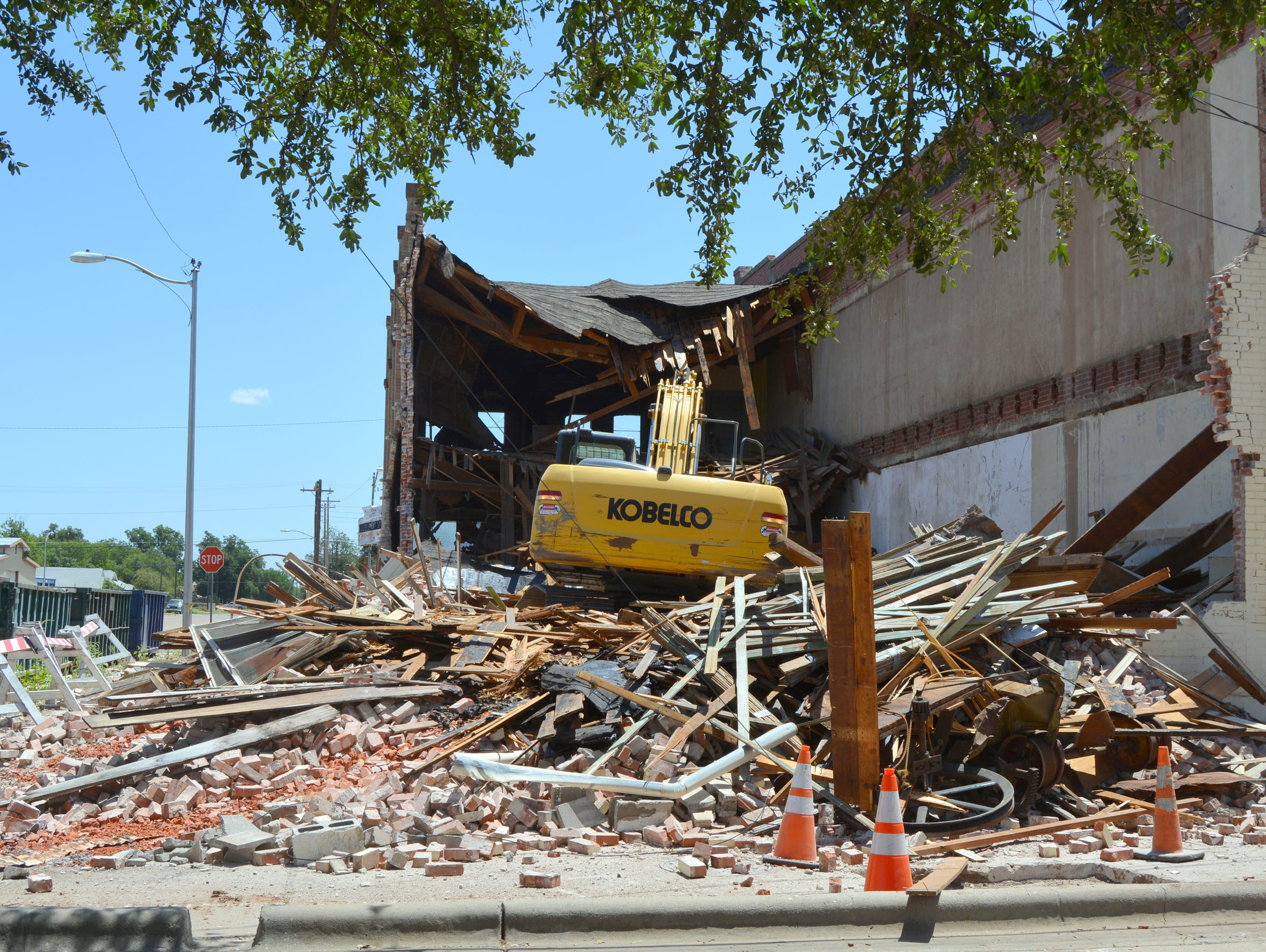 Heavy equipment tears down the old Bowdens Department