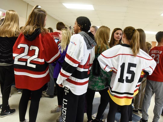 Students wear hockey jerseys in tribute to the families