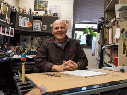"""UMES Assistant Professor of Art Brad Hudson is shown at his campus office. Hudson recently acquired a contract drawing """"Star Wars"""" characters with Topps."""