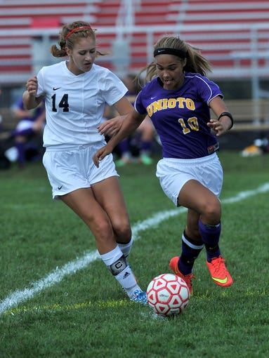 Unioto's Kayla Peele and Fairfield Union's Justine Foster fight for control of the ball during Saturdays game, Aug. 30, 2014, at Fairfield Union High School in Rushville. The Falcons won the game 5-3.