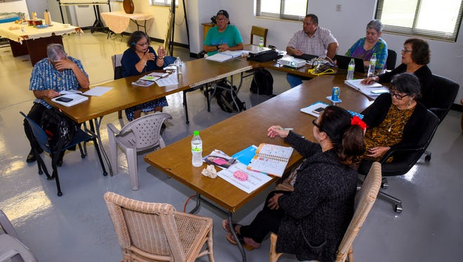 Rosa Palomo, second from left, address members of the Kumision I Fino CHamoru yan I Fina'nå'guen I Historia yan I Lina'la' I Taotao Tåno', or the Commission on Chamorro Language and the Teaching of the History and Culture of the Indigenous People of Guam, during a meeting in Hagåtña on Tuesday, Oct. 24, 2017.