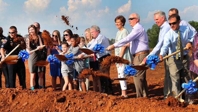 Several people participated in the turning of ground as Murfreesboro City Schools held a Groundbreaking for the city's 13th Elementary School on Tuesday afternoon, July 17, 2018. The school has not yet been named. Southwest Elementary is on the rendering because that is the school's location in the city.