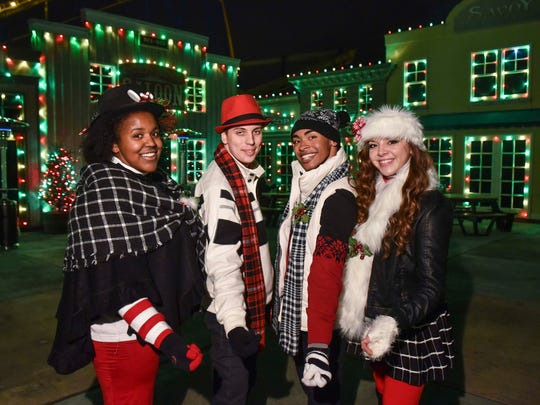 The Jingle Jammers carolers perform during Six Flags Great Adventure's Holiday in the Park.