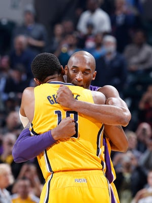 INDIANAPOLIS, IN - FEBRUARY 8: Paul George #13 of the Indiana Pacers gets a hug from Kobe Bryant #24 of the Los Angeles Lakers before the game at Bankers Life Fieldhouse on February 8, 2016 in Indianapolis, Indiana.