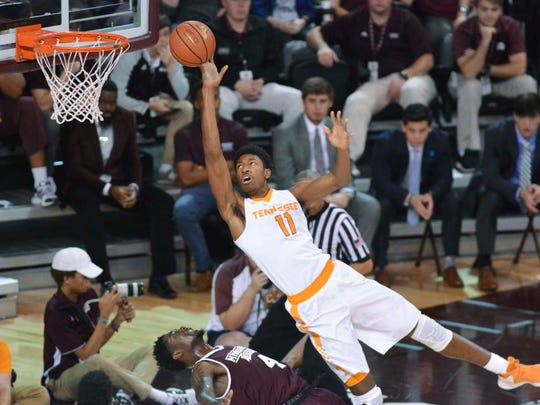 Tennessee forward Kyle Alexander shoots over Mississippi State guard Mario Kegler during Saturday's game in in Starkville, Miss.