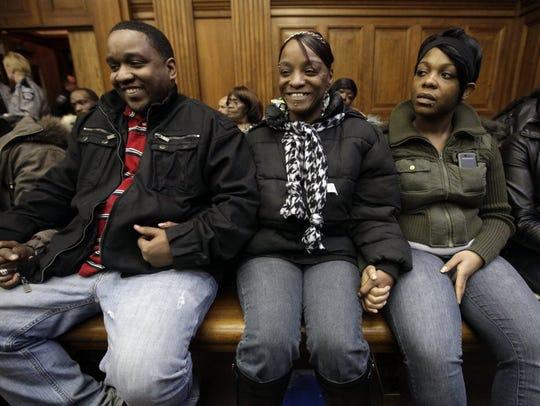 Derek Williams' mother Sonya Moore (center) reacts