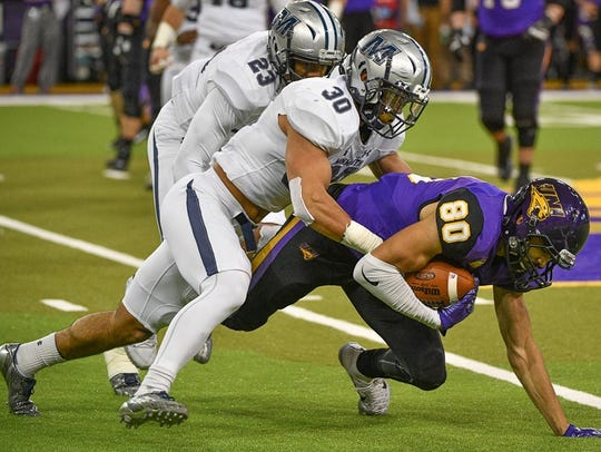 Monmouth safety Mike Basile, shown making a tackle