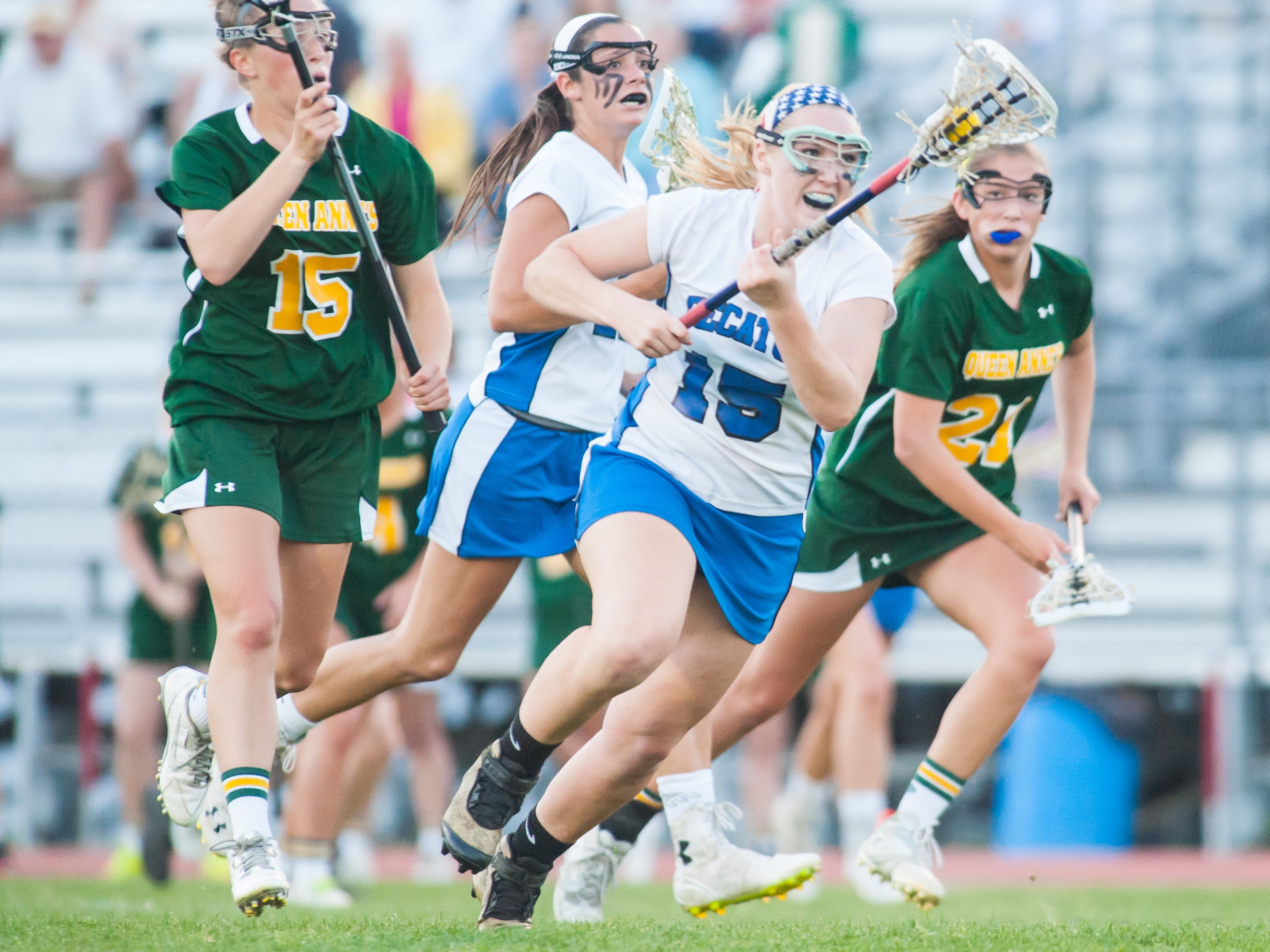 Stephen Decatur midfielder Elle Bargar (15) fights to the offensive zone against Queen Annes' on Tuesday evening at Wicomico County Stadium in the Bayside Girls Lacrosse Championship.