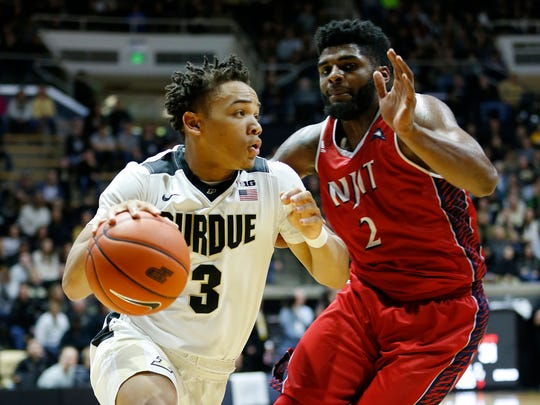 Carsen Edwards with a drive against Tim Coleman of