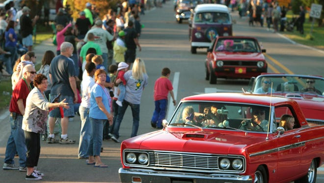 Spectators line Cleveland Avenue to watch the classic cars roll in the Cruisin' The Coast parade in Long Beach.