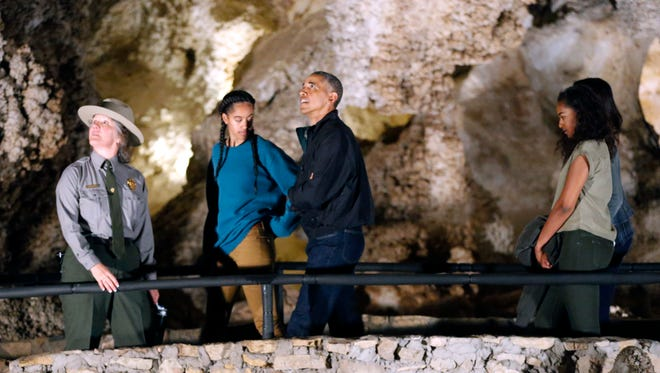 A Carlsbad Caverns National Park public affairs specialist, Valerie Gohlke, left, gives Malia Obama, President Barack Obama, Sasha Obama and Michelle Obama, who is not shown, a tour of the cave June 17, 2016, southwest of Carlsbad, N.M.