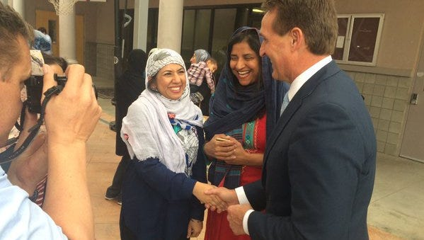 Sen. Jeff Flake meets members of the Islamic Center of the Northeast Valley in Scottsdale on Dec. 11, 2015. Flake said Muslims and Mormons have much in common; Flake is Mormon.