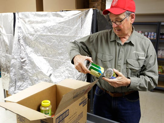 James Thome, Salvation Army Food Pantry volunteer, enjoys helping those in need. The Salvation Army's food pantry is a busy place in Oshkosh, November 14, 2017.