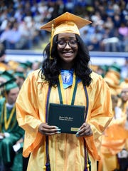 Bubbling over with joy on graduation day is Jayla Meeks. Among challenges she had to overcome was being homeless.